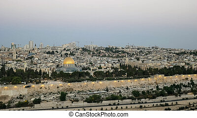 dawn view of the dome of the rock from the mount of