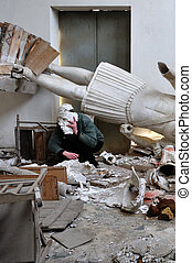 day after - Obscured figure among ruins broken statues and...