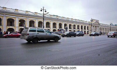 Day car traffic and crowdy pavement of Nevsky prospect -...