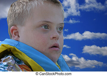 Day Dreaming Boy - A young boy with down sydrome with a look...