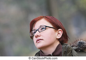 Day dreaming - Portrait of a redheaded girl with glasses ...