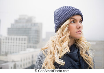 Day dreaming pretty blonde posing outdoors on urban ...