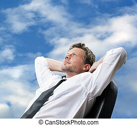 Day Dreaming - Portrait of a mature business man while...