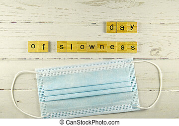 day of slowness.words from wooden cubes with letters