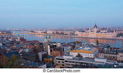 Day to night time-lapse. Budapest with the Danube and the Parliament building, Hungary. Aerial view of Budapest. Hungary. Time-lapse. Evening.