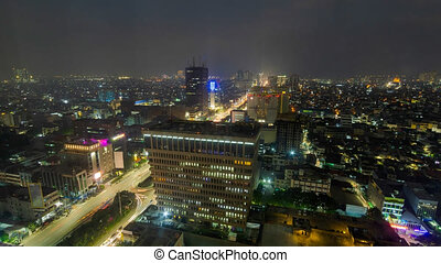 Day To Night Time Lapse Of Jakarta City, Indonesia From High Vantage Point Of View. Camera Pan Down