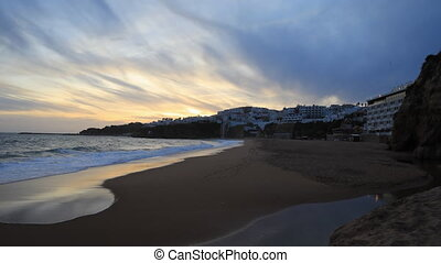 Day to night timelapse of the beach at Albufeira in Portugal