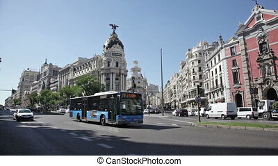 Day traffic near The Metropolis building, Madrid - Day car...