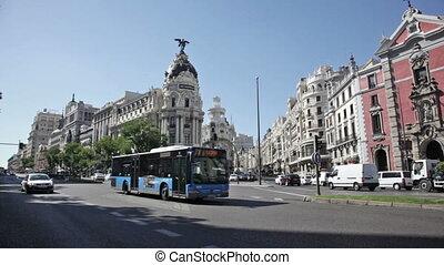 Day traffic near The Metropolis building, Madrid - Day car...