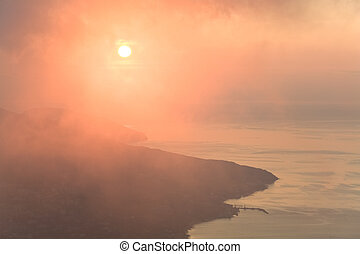 Daybreak coastline landscape from Aj-Petri Mountain top (Crimea, Ukraine) and view on Jalta City.