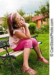 Daydream - child in garden