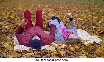 Daydreaming couple enjoying romantic date in autumn -...