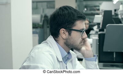 Daydreaming - Man taking break from laboratory research and...