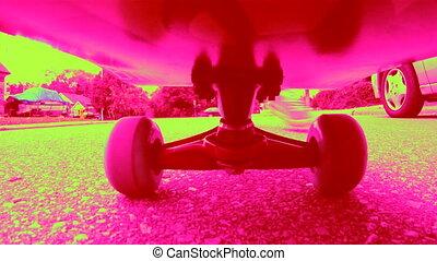 Dayglo Skateboard. Starting and sto - Riding a skateboard...