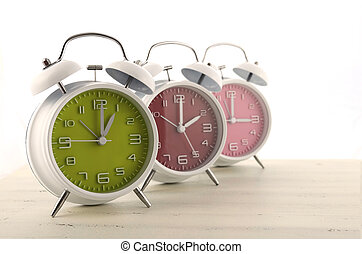 Daylight Saving Time concept with three colorful retro style...