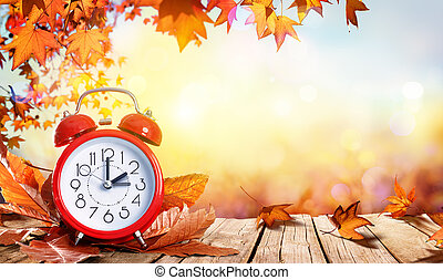Daylight Savings Time Concept - Clock And Leaves On Wooden...