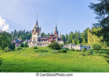 Daylight side far view to Peles castle front facade with...