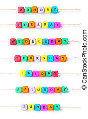 Days of the week, a weekly calendar from multi-colored cubes...