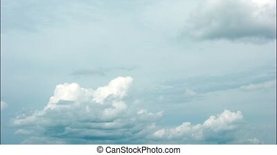 Daytime timelapse video in 5k resolution - cumulus clouds above the horizon