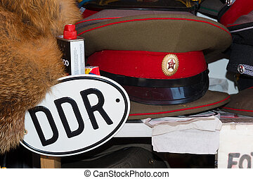 DDR cap and sign - Sale stand of Soviet and DDR militaria...