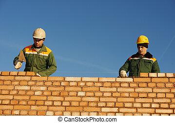 de arbeider van de bouw, bricklayers, metselaar