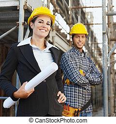de arbeider van de bouw, en, architect