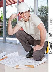 de arbeider van de bouw, jonge, smart
