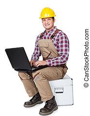 de arbeider van de bouw, met, draagbare computer