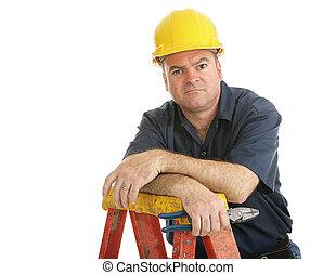 de arbeider van de bouw, ontevreden