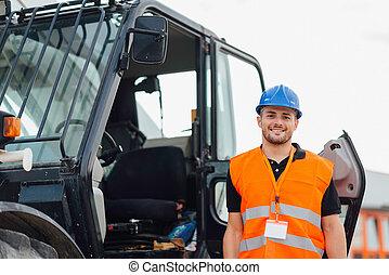 de arbeider van de bouw, slippen, stuur, lader