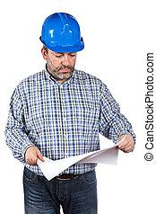 de arbeider van de bouw, vasthouden, blauwdruken