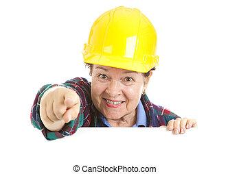 de arbeider van de bouw, vrouwlijk, wijzende
