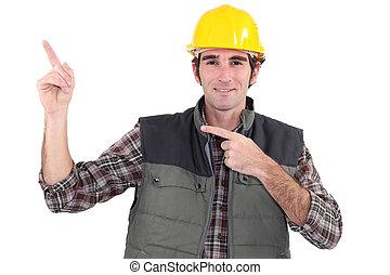 de arbeider van de bouw, wijzende