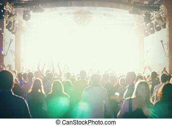 De-focused concert crowd. a lot of fans at a rock concert.
