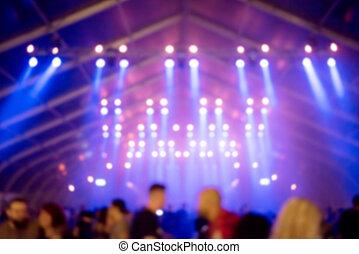 De-focused concert crowd and stage lights