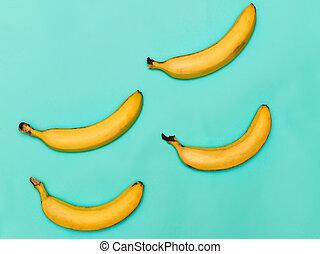 de, groep, van, bananen, tegen, blauwe achtergrond
