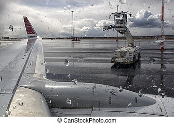 De-icing an aircraft wing - the machine washes the airplane...