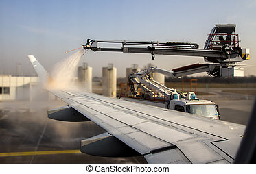 De-icing of an airplane at Munich Airport, Germany, 2015 -...