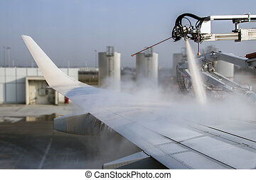 De-icing of an airplane at Munich Airport, Germany, 2015