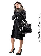 de, jonge vrouw , in, een, black , coat., vrijstaand