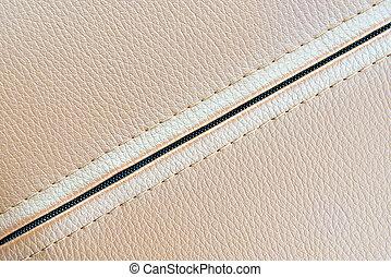 de, leder, textuur, achtergrond, in, de, licht bruin, toon, met, de, zipper.closeup, van, de, leder, textuur, met, zipper