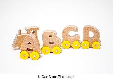 de madera, cartas, un, b, c, d, de, un, tren, alfabeto, y, locomotora, con, amarillo, ruedas, blanco, fondo., niñez temprana, educación, aprender leer, preescolar, y, juego niños, concept.