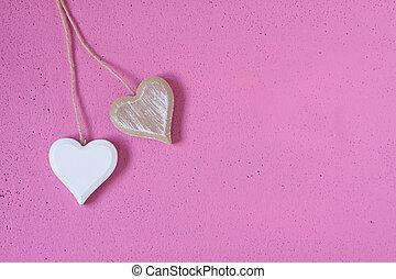 de madera, corazones, en, un, fondo rosa