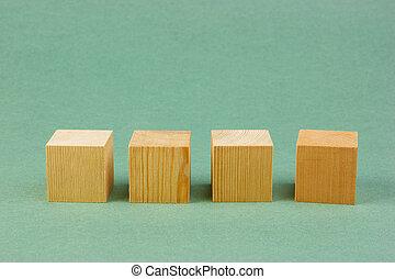 de madera, geométrico, cubo, en, un, fondo verde