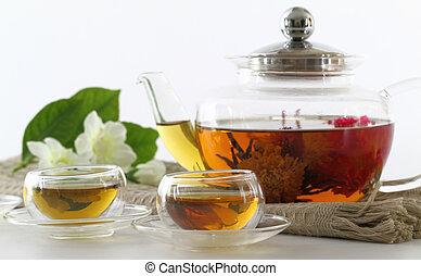 de pot van de thee, koppen