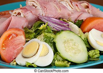 de salade van chef-kok