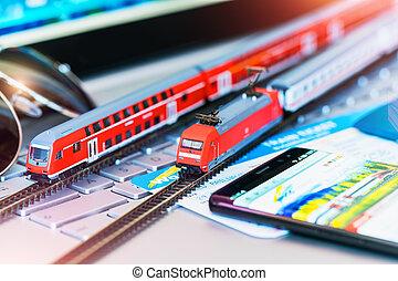 de trein van het stuk speelgoed, draagbare computer, kaartjes, aantekenboekje, bank, paspoort, of, kaart