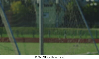 dead ball and corner kick by soccer player, blurred for...