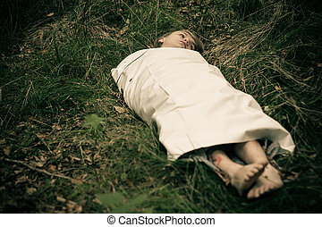Dead body of young male murder victim - Murdered boy wrapped...