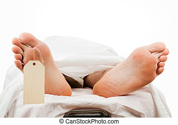 Closeup of a corpse on a gurney wearing a toe tag. Isolated with clipping path.
